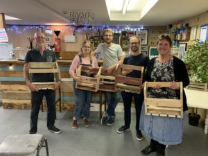 Class attendees with their wine racks - woodwork